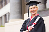 Woman with graduation cap and gown — Stock Photo