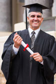 Middle aged male graduate — Stock Photo