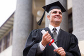 Optimistic senior university graduate — Stock Photo