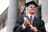Optimistic senior university graduate — Stock Photo