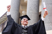 Excited middle aged university graduate — Stock Photo