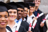 Happy graduates with daplomas in hands — Stock Photo