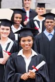 College students in graduation gown — Stock Photo