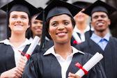 Optimistic university graduates — Stock Photo