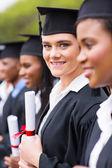 Univerzitní absolvent stojící v řadě — Stock fotografie