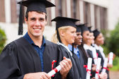 Cheerful college graduates — Stock Photo