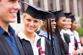 Pretty university student in graduation attire — Stock Photo