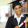Pretty female african college graduate — Stock Photo #42490111