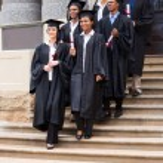 Graduates walking down the stairs — Stock Photo