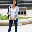 College student outside school building — Stock Photo #42492531