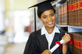 Pretty female african college graduate — Stock Photo