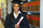 Student with diploma wearing graduation attire — Stock Photo