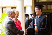 Father congratulating his son — Stock Photo