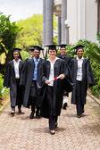 Graduates walking to ceremony — Stock Photo