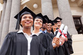College graduates standing in row — Stock Photo