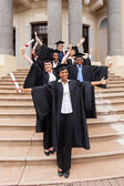 Graduates outside college building — Stock Photo