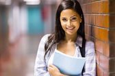 Female college student standing by passage — Stock Photo
