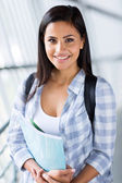 Female university student smiling — Stock Photo