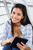 Woman holding tablet computer — Foto Stock