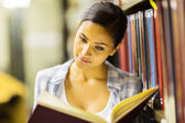Student reading in library — Stock Photo