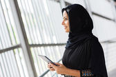 Muslim woman with tablet computer — Stock Photo