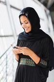 Islamic woman using smart phone — Foto Stock