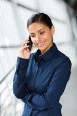 Businesswoman talking on smart phone — Stock Photo