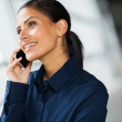 Office worker talking on cell phone — Stock Photo #42511497