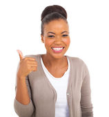 African businesswoman with thumb up gesture — Stock Photo
