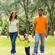 Young indian family walking in park — Stock Photo #44309059