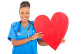 African american healthcare worker with heart symbol — Stock Photo
