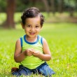 Little boy sitting on a green grass — Stock Photo #44310711