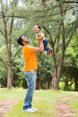 Happy young father playing with son — Stock Photo