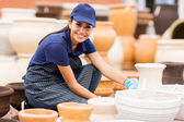 Hardware store worker working in home and garden center — Stock Photo