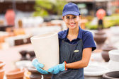 Hardware store worker holding plant pot — Stock Photo