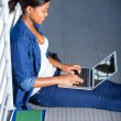 Female african american student using laptop — Stock Photo #44715009