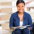 Female african college student sitting on steps — Stock Photo