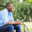 Young african man sitting outdoors — Stock Photo