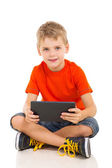 Young boy with tablet computer — Stock Photo