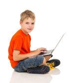 Caucasian boy using laptop — Stock Photo
