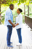 African american couple holding hands — Stock Photo