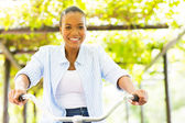African woman riding a bike — Stock Photo