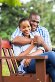 Young african american couple sitting at the park — Stock Photo