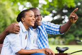 Afro american couple relaxing outdoors — Stock Photo