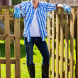 Man standing at garden gate — Stock Photo