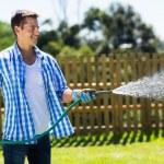 Man watering garden — Stock Photo #46009411