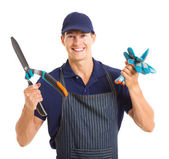Gardener holding gloves and garden shears — Stock Photo