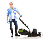 Man standing near lawnmower — Stock Photo