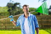 Man holding fan rake — Stock Photo
