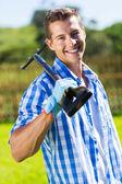 Man holding a garden fork — Стоковое фото